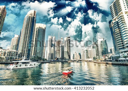 Buildings and skyline of Dubai Marina at dusk. - stock photo