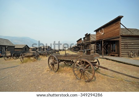 buildings and wagons in historic cowboy ghost town, Wyoming - stock photo