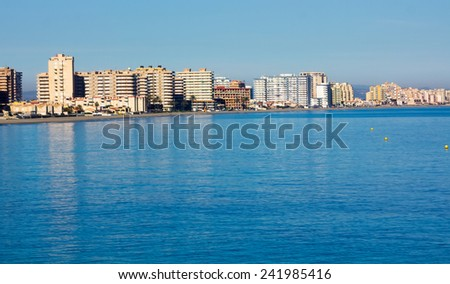 buildings by the sea and the beach in La Manga, Murcia, Spain - stock photo