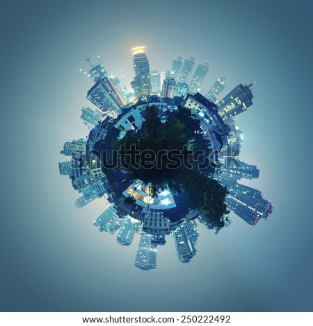 Buildings forming the globe at night - stock photo