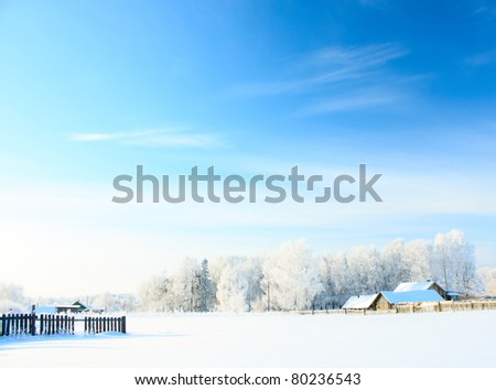 Buildings in a village at sunny winter day with blue sky - stock photo