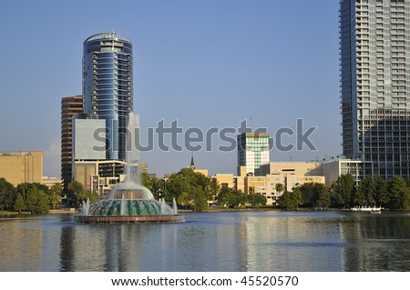Buildings in downtown Orlando, Florida as seen from Lake Eola Park - stock photo