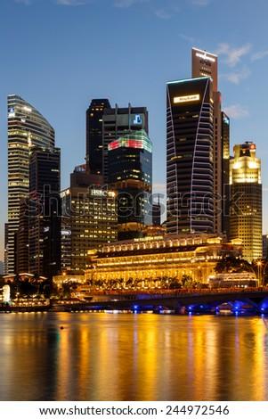 Buildings in Singapore city in night scene background , Singapore - 17 Jan 2015 - stock photo