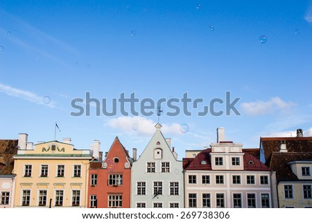 Buildings of the central Town Hall Square in Tallinn and the blue sky with bubbles