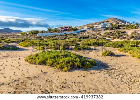 Buildings On Sotavento Beach During Clear Summer Day - Fuerteventura, Canary Islands, Spain - stock photo