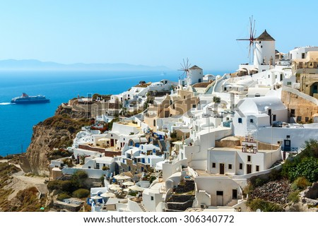 Buildings on the hill in the famous Oia town, Santorini island, Greece - stock photo