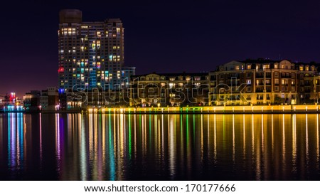 Buildings on the waterfront at night in the Inner Harbor, Baltimore, Maryland. - stock photo