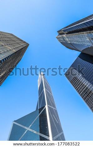 Buildings towering sky in blue sky. - stock photo