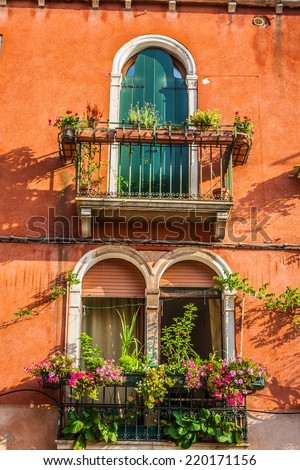 Buildings with traditional Venetian windows in Venice, Italy - stock photo