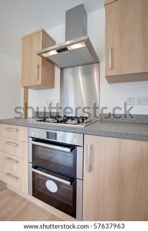 Built in appliances within new modern kitchen - stock photo