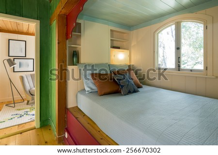 Built-in bed, Bedroom Nook with pillows in wooden house.  - stock photo