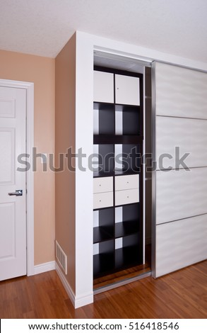 Built-in closet with sliding door shelving storage organization solution, empty shelves