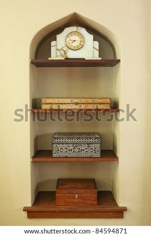 Built in shelf with boxes and clock - stock photo