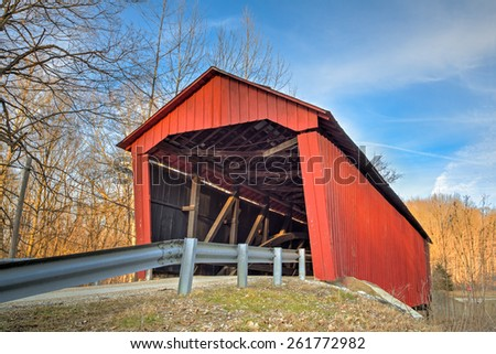 Built in 1922, the Edna Collings Covered Bridge is one of nine historic spans in Putnam County, Indiana. - stock photo