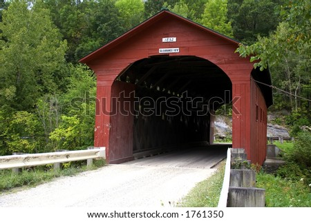 Built in 1852 this covered Bridge crosses the Battenkill river in Western Vermont and is a National Historic Landmark. - stock photo