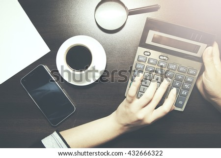 buinesswoman working on  the wooden table - stock photo