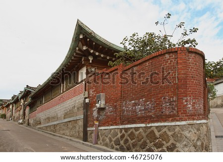 Bukchon is a unique and noted place in Seoul, KOREA.Where one can find the trace of traditional life of the ancestors through the Korean traditional houses,  alleys and the activities of artisans. - stock photo