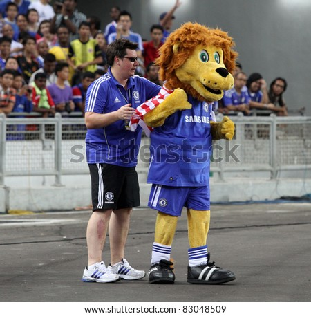 BUKIT JALIL, MALAYSIA - JULY 19: Chelsea's mascot wearing the Malaysian flag on it's back during the team's practice session in the National Stadium on July 19, 2011 in Bukit Jalil, Malaysia. - stock photo
