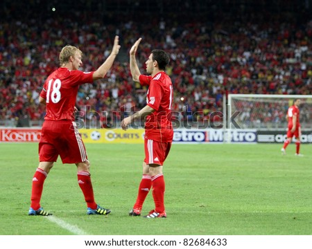 BUKIT JALIL, MALAYSIA - JULY 16: Liverpool's Dirk Kuyt (18) celebrates after scoring against Malaysia in his game at the National Stadium on July 16, 2011, Bukit Jalil, Malaysia. Liverpool won 6-3. - stock photo