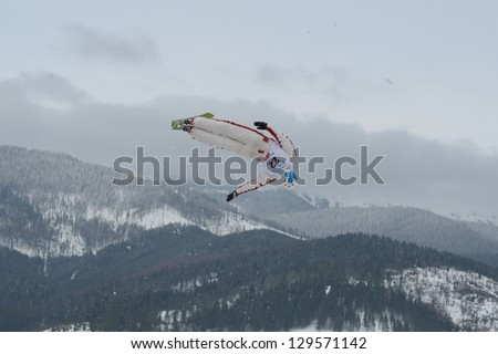 BUKOVEL, UKRAINE - FEBRUARY 23: Jean-Christophe Andre, Canada performs aerial skiing during Freestyle Ski World Cup in Bukovel, Ukraine on February 23, 2013.