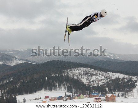BUKOVEL, UKRAINE - FEBRUARY 23: Michael Rossi, USA performs aerial skiing during Freestyle Ski World Cup in Bukovel, Ukraine on February 23, 2013.