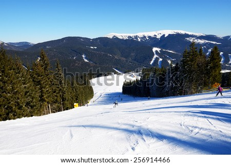 BUKOVEL, UKRAINE - FEBRUARY 17: The skiers are on a slope in Bukovel. It is the largest ski resort in Ukraine, February 17, 2015 in Bukovel, Ukraine