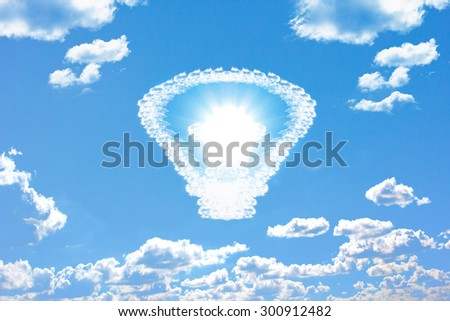 Bulb made of clouds and sun bright in blue sky with ecology conception symbolizing the solar energy - stock photo