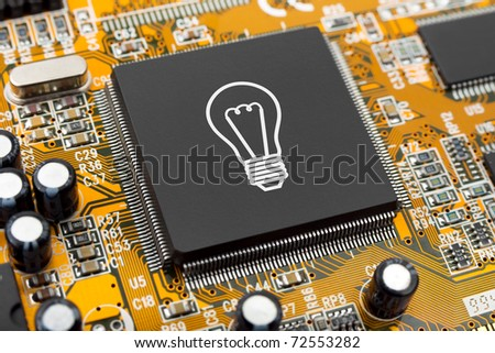 Bulb on computer chip - technology concept - stock photo