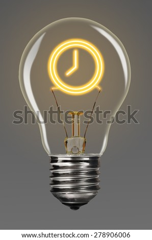 bulb with glowing clock sign inside of it, creativity concept - stock photo