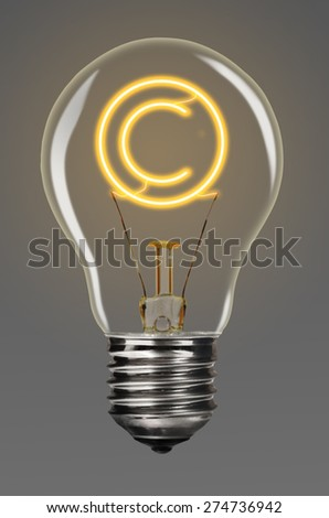 bulb with glowing copyright sign inside of it, creativity concept - stock photo