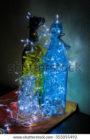 Bulbs in the bottle. Led light bulb glow,Bulbs in the bottle. Led light bulb glow, decor - stock photo