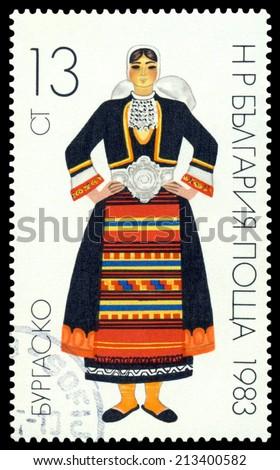 BULGARIA - CIRCA 1983: a stamp printed by Poland shows  Woman  Bulgarian National Costumes, circa 1983 - stock photo