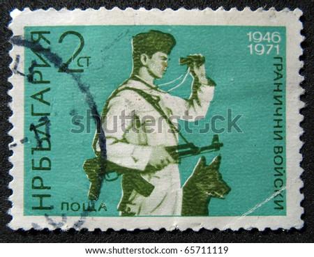 BULGARIA - CIRCA 1971: A stamp printed in BULGARIA shows Bulgaria's border with a dog, circa 1971. - stock photo
