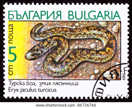BULGARIA - CIRCA 1989:  A stamp printed in Bulgaria shows the Javelin Sand Boa Constrictor Snake, Eryx jaculus, circa 1989. - stock photo