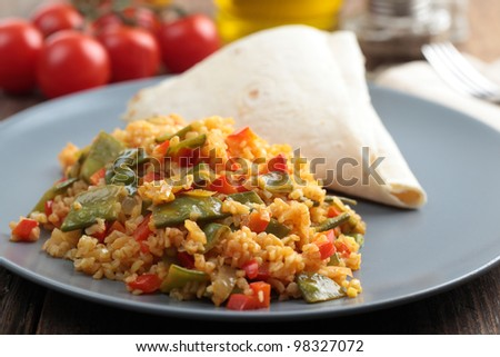 Bulgur pilaf on a plate closeup