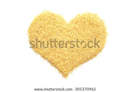 Bulgur wheat in a heart shape, isolated on a white background - stock photo