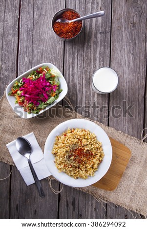 Bulgur with ayran and salad.selective focus on wooden background , kuskus - stock photo