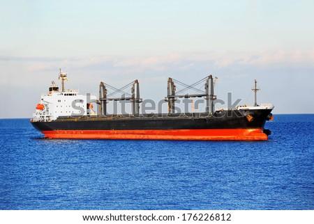 Bulk cargo ship in Odessa harbor quayside - stock photo