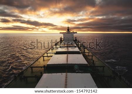 Bulk cargo ship underway viewed from bow - stock photo