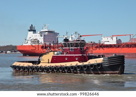 Bulk carrier on Mississippi River with Tug - stock photo