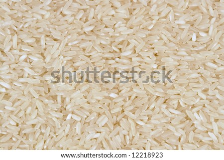 Bulk whole grain instant cooking rice background texture - stock photo