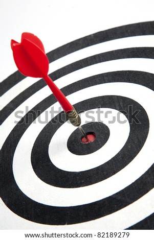 Bull's eye of a dart hitting  the middle of dartboard - stock photo