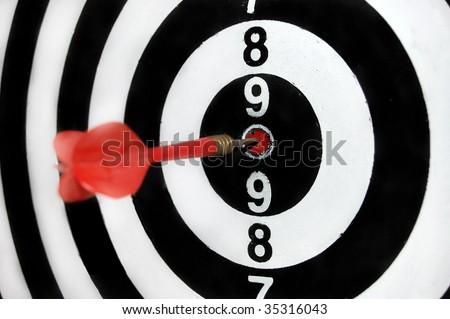Bull's eye on a dart board - stock photo