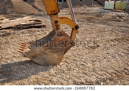 Bulldozer excavator on a construction site, detail of the bucket - stock photo