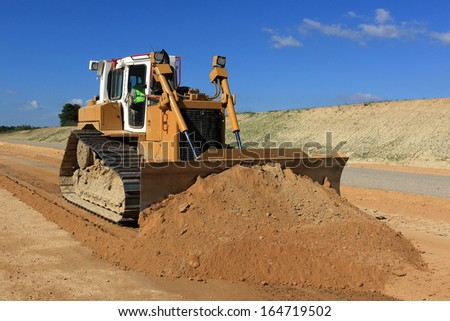 bulldozer in action on a construction site - stock photo