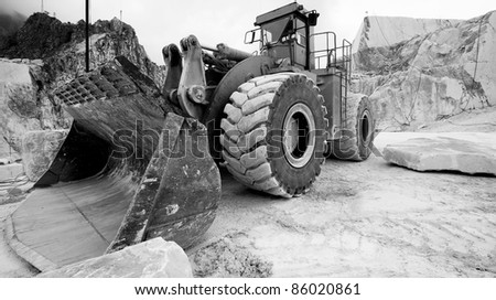 Bulldozer in quarrie , Carrara, Italy , B&W conversion - stock photo