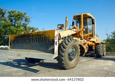 bulldozer in the parking lot. - stock photo