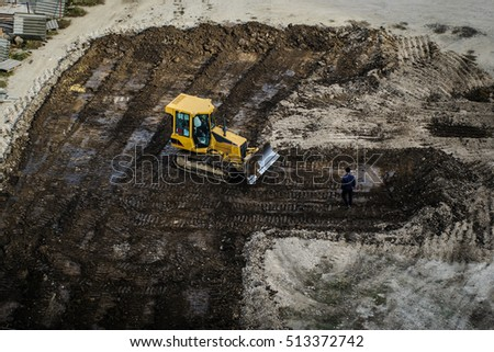 bulldozer is working hard and dig dich
