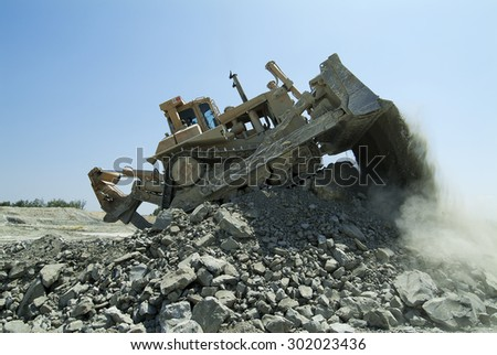 Bulldozer Machine Earthmoving Vehicle in Dynamic Action - stock photo