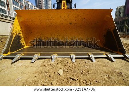 bulldozer on a building site - stock photo